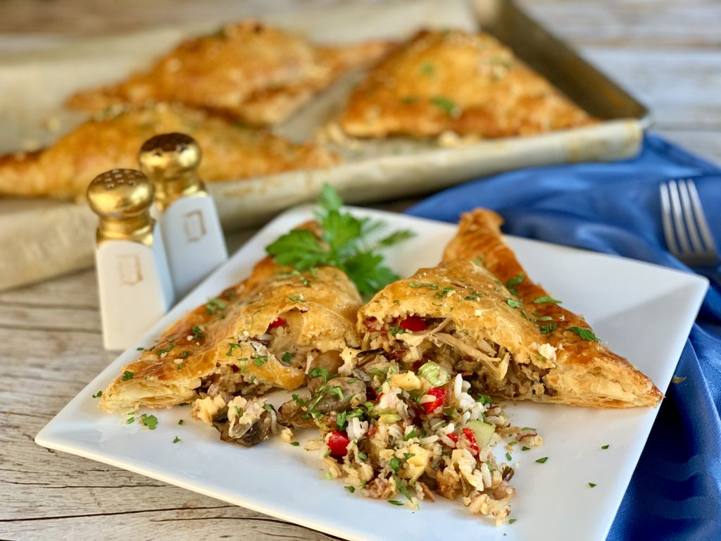 Chicken And Wild Rice Turnovers Laced With Smoked Gouda And Wild Mushrooms
